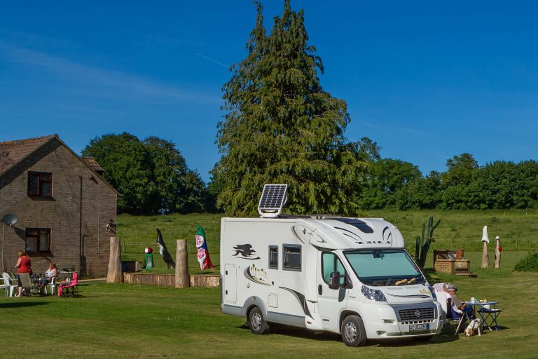 Tilshead grounds, with garden furniture and motorhome, Brades Acre Camping Site, Stonehenge, Wiltshire, Salisbury, camping, holiday lodges