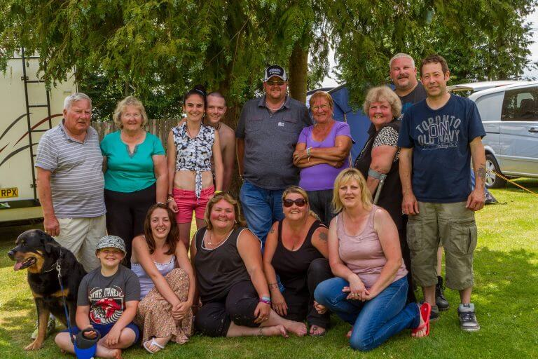 Group photo of 23 adults, one child and one good dog, Brades Acre Camping Site, Stonehenge, Wiltshire, Salisbury, camping, holiday lodges