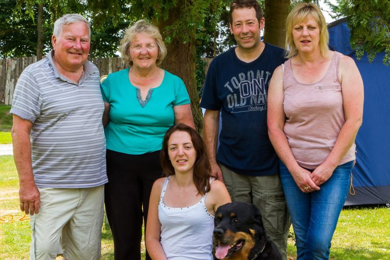 Group photo of five adults and one very good dog, Brades Acre Camping Site, Stonehenge, Wiltshire, Salisbury, camping, holiday lodges