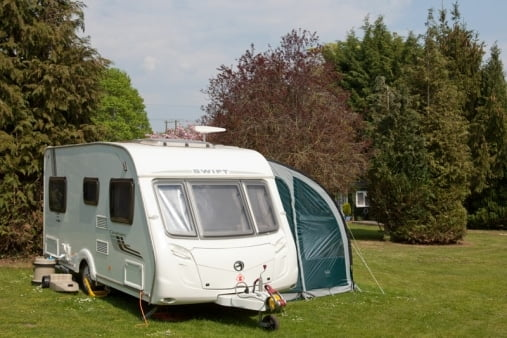 Caravan on campsite grounds, Brades Acre Camping Site, Stonehenge, Wiltshire, Salisbury, camping, holiday lodges